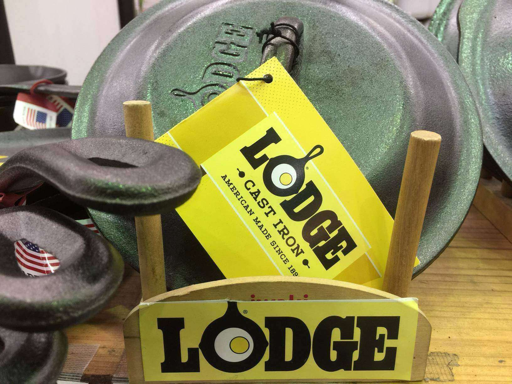Skillet cover rack with skillet lids. Lodge label in front and yellow label on skillet cover.