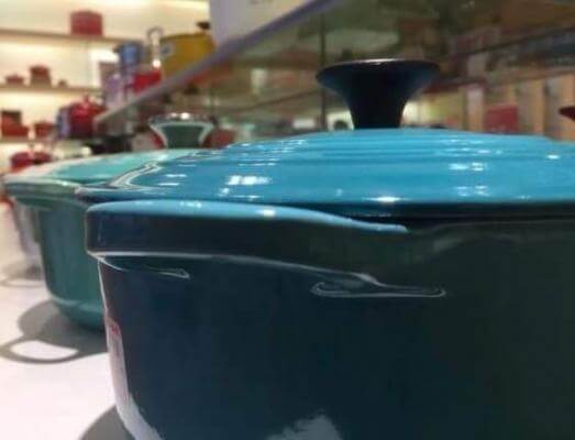 Close up of a blue Le Creuset dutch oven.