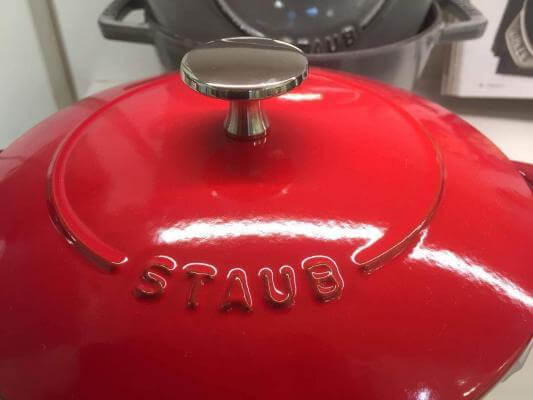 Red Staub French oven on display.