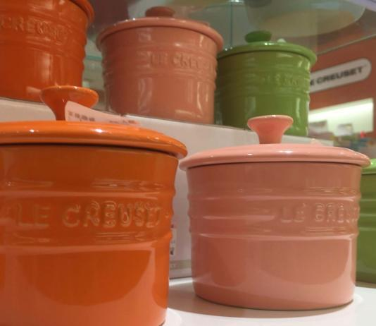 Cute Le Creuset storage dishes. (In the picture two rows of Le Creuset storage dishes are on display. The colours displayed from left to right are: orange, pink and green). What are the benefits of ceramic cookware? With so many reasons it's hard to know where to start. Come to Boonie Hicks to learn more.