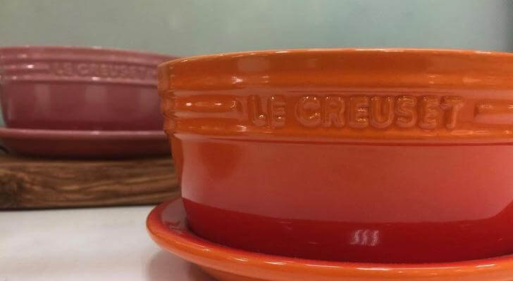 Le Creuset Ceramic cookware (In the Picture is two ceramic dishes one orange the other rose pink).