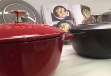 Two Staub Dutch ovens. One Red the other is black. The knobs are made of brass and both are some of the best Dutch ovens you can buy