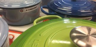 Why is Le Creuset cookware so expensive? (In the picture of different Le Creuset ovens on a table).