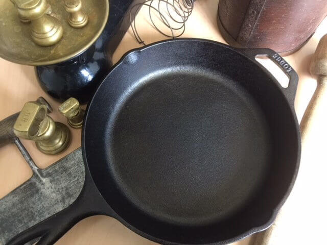 What are the benefits of cooking in cast iron? In the picture is a lodge cast iron skillet