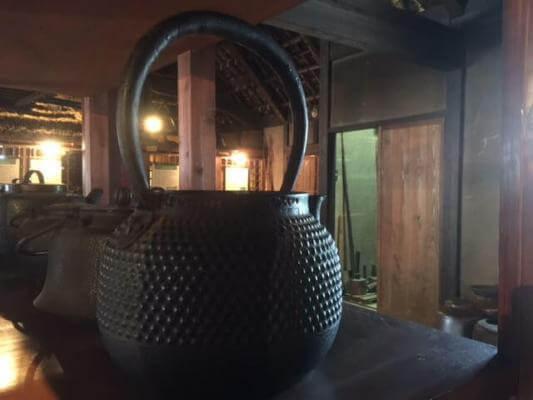 Very old Japanese tea kettles on display