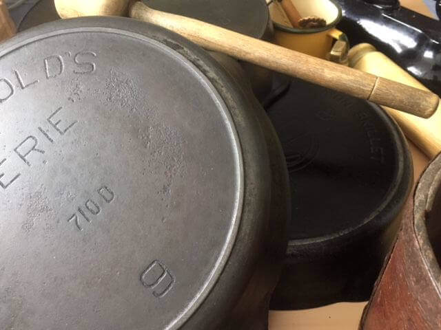 Vintage skillets on a table.