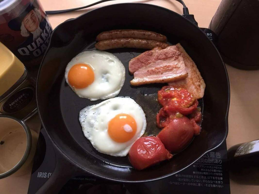 English breakfast cooking in a vintage cast-iron skillet