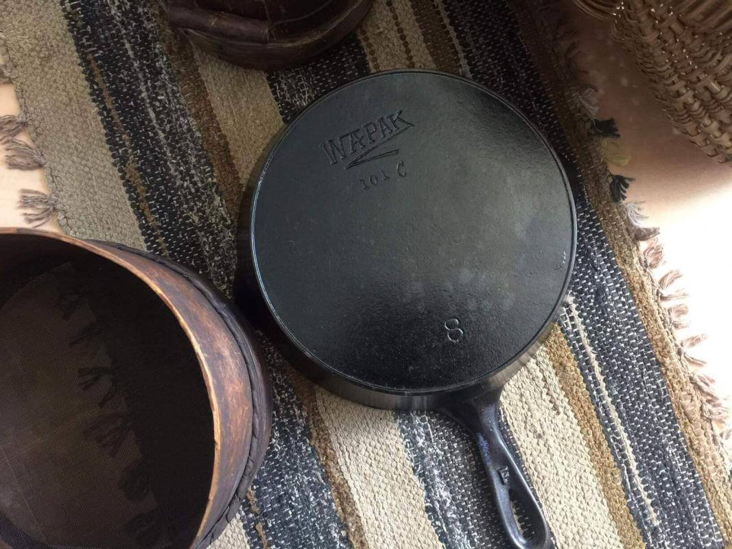 Wapak Hollow Ware Co. Wapak No8 skillet on a table. In the picture, the Z logo is clearly seen.