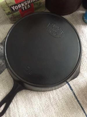 Favorite Piqua Ware skillet with smiley logo made by Favorite Stove and Range.