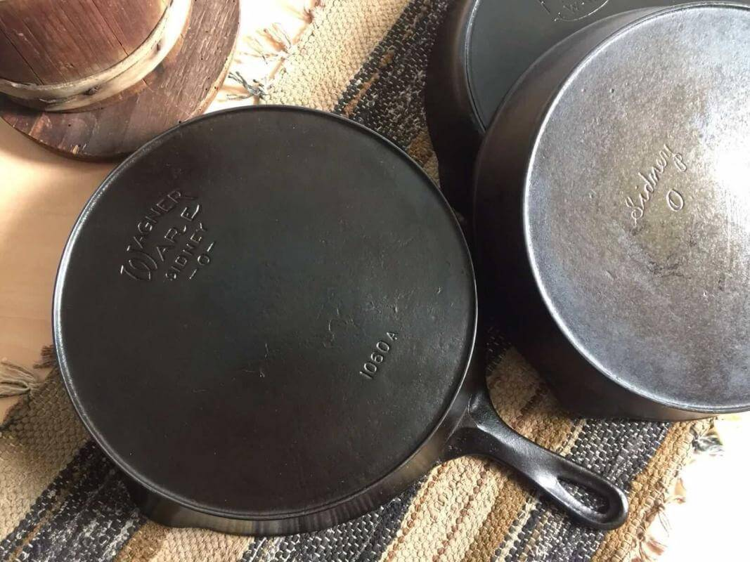 Wagner cast iron with two other antique cast iron skillets.