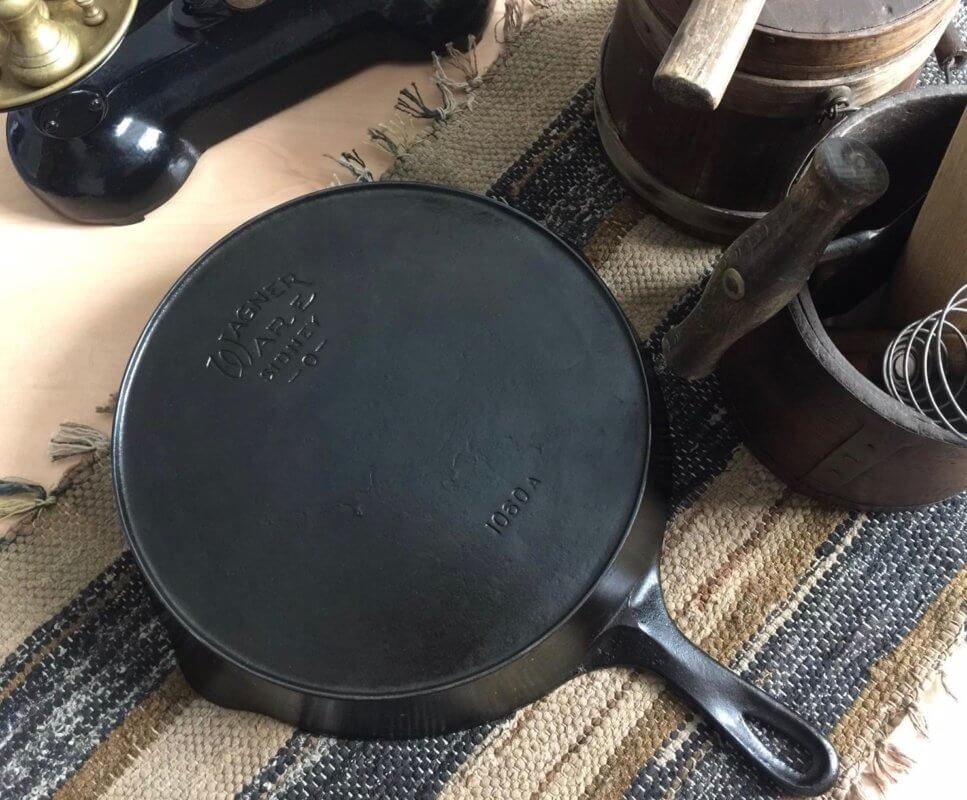 Wagner cast iron skillet on a table. This skillet shows this Wagner Ware Sidney O logo