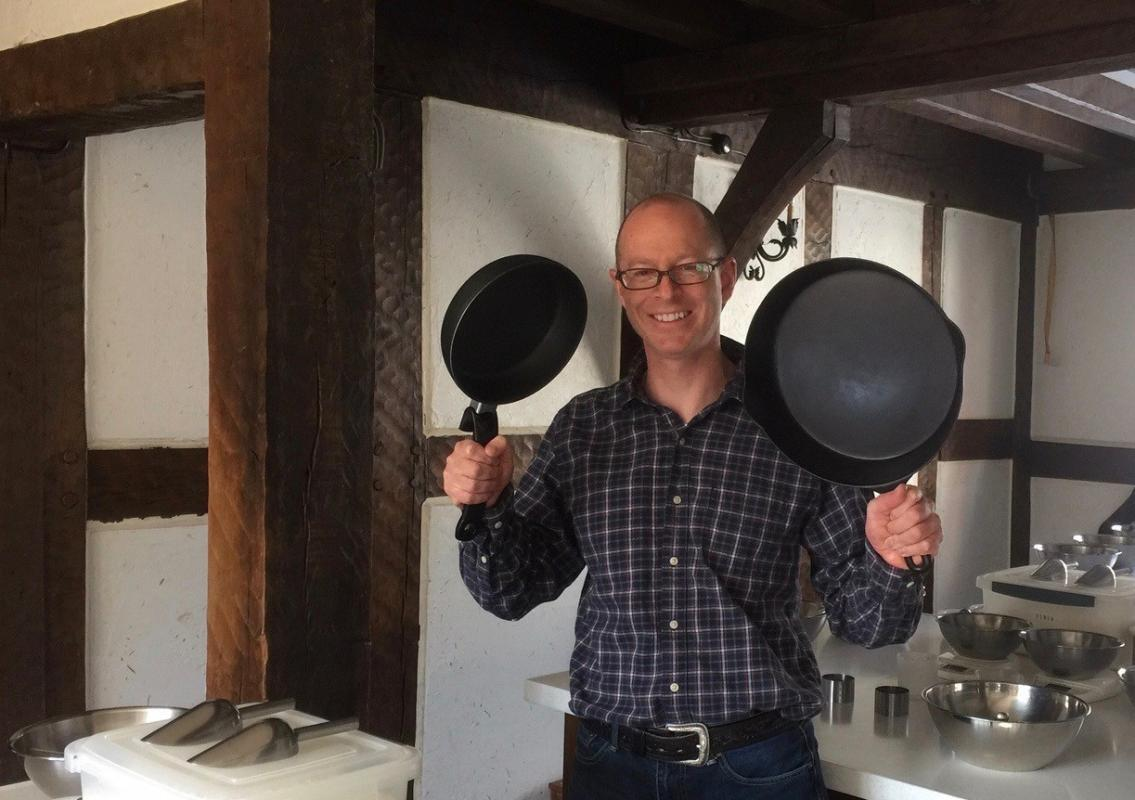 Is cast iron cookware safe to use? Picture Brett Standeven holding tow frying pans
