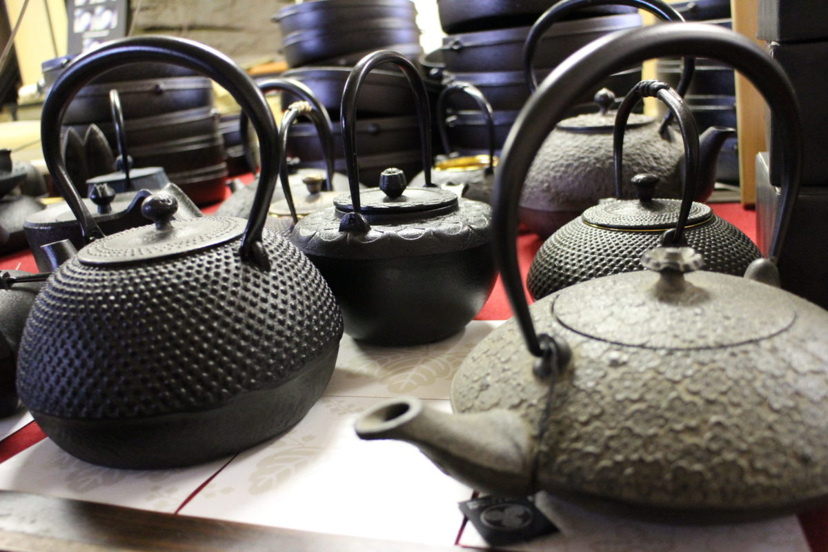 Display of Oitomi cast iron kettles and teapots