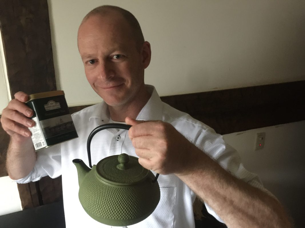 Brett Standeven (Boonie Hicks) holding a Iwachu teapot