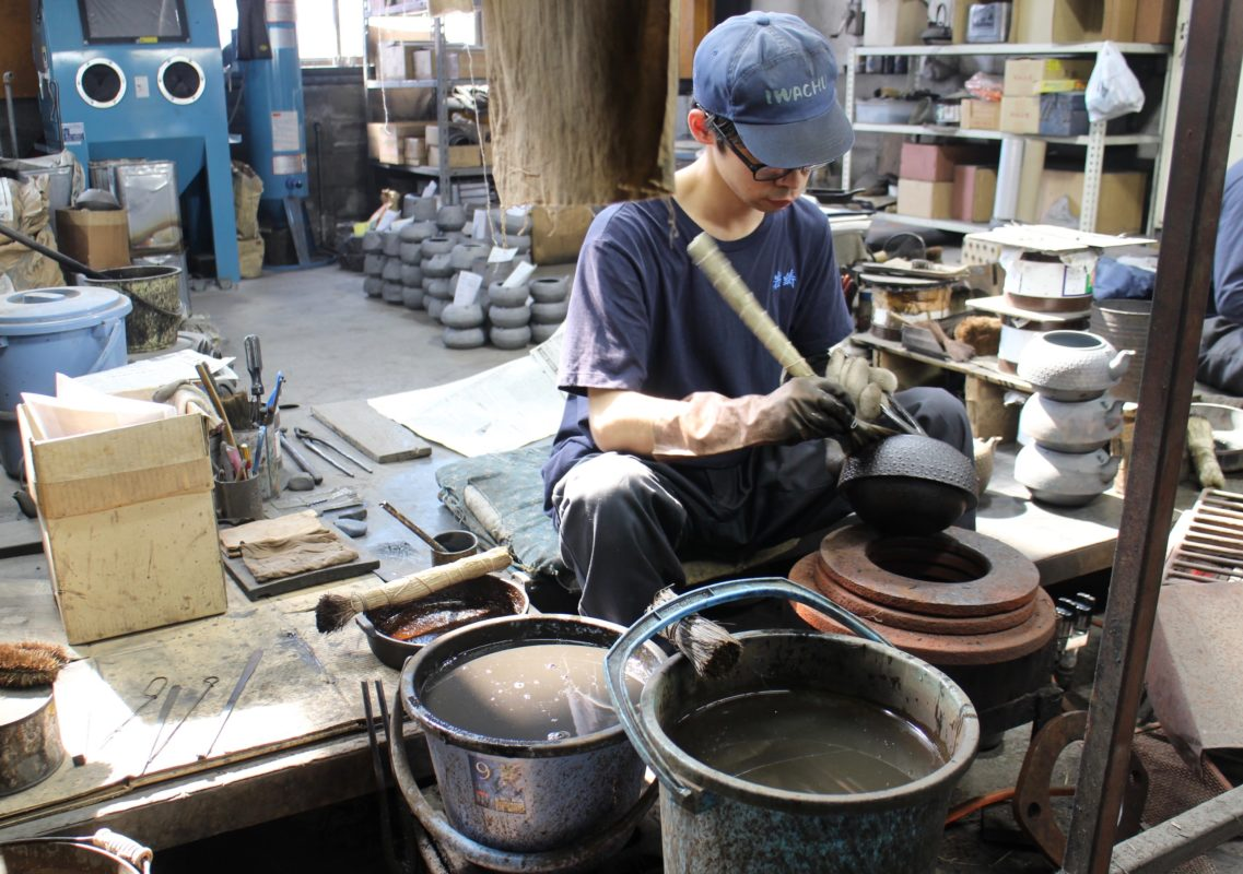 Iwachu cast iron foundry worker