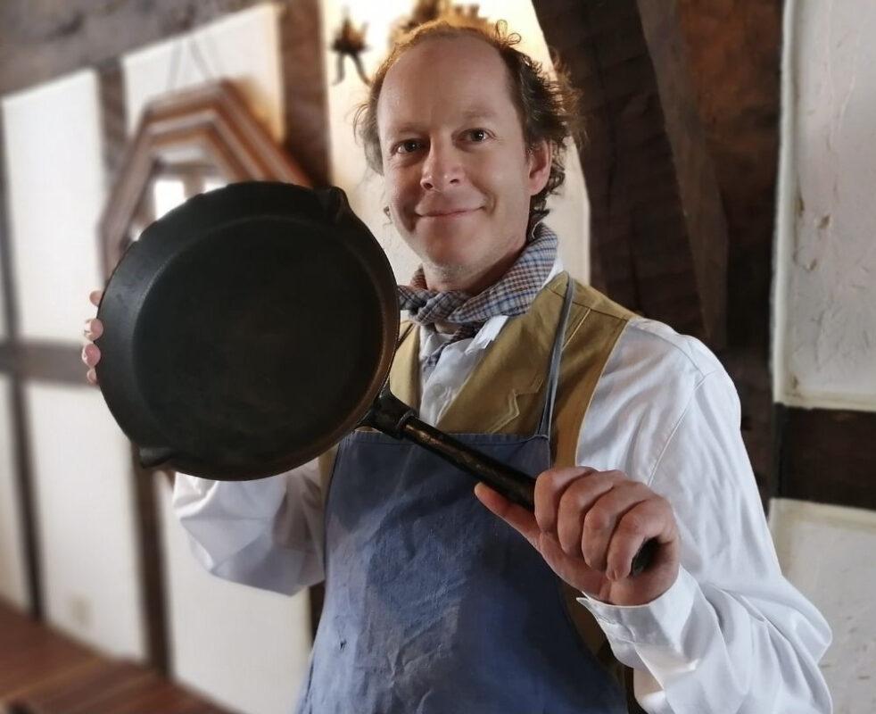 Brett Standeven holding antique skillet
